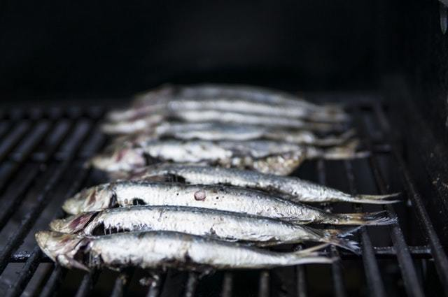 Trout smoking on a grill.