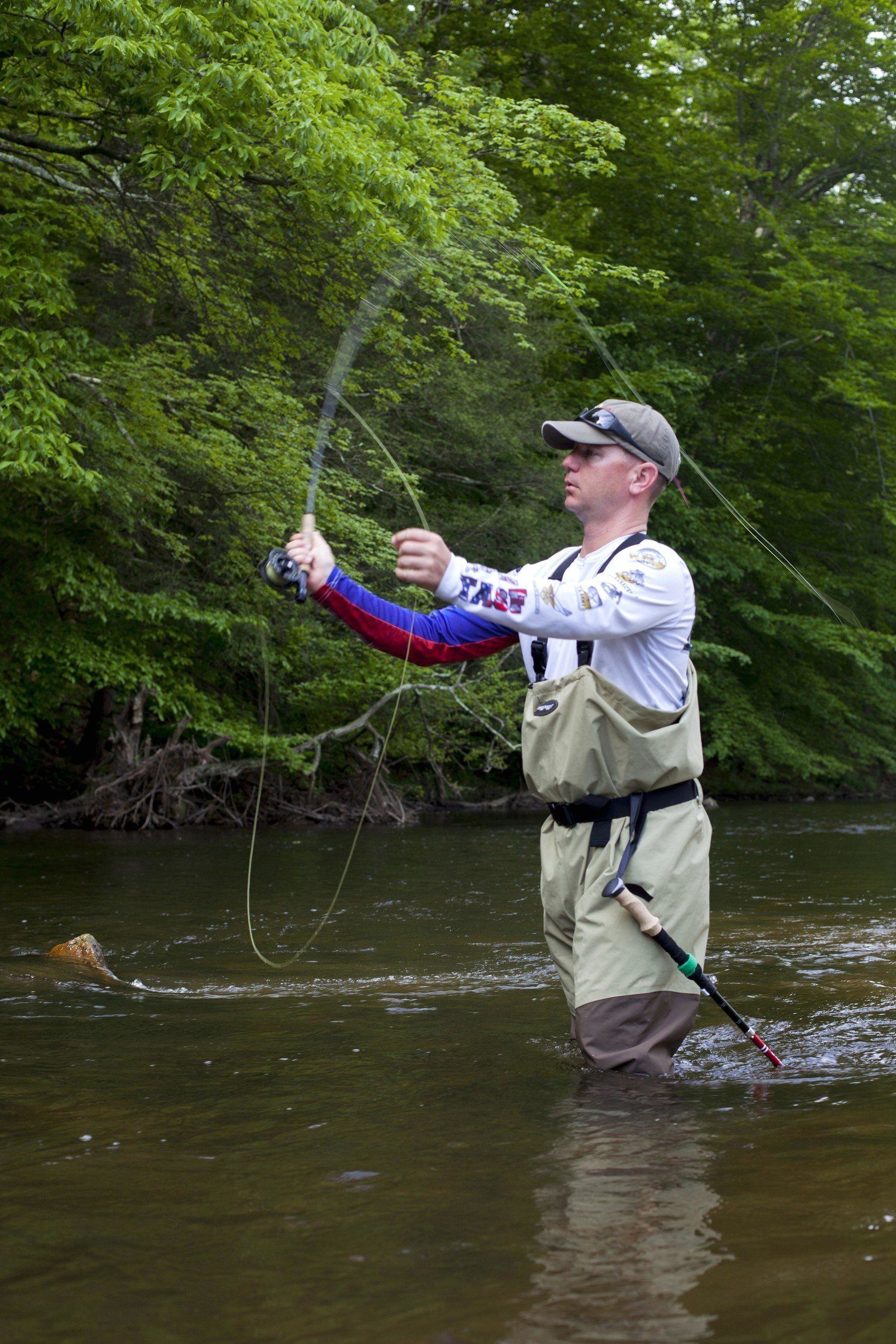 Man fly fishing in stream.