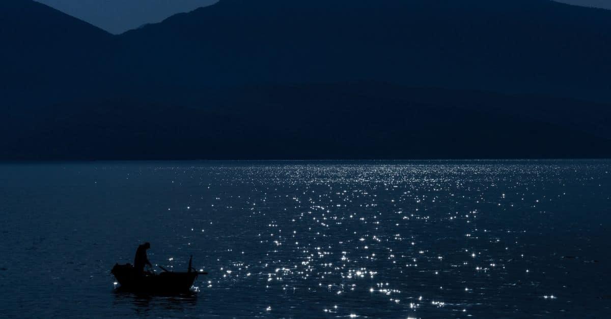 Boat on a lake at night