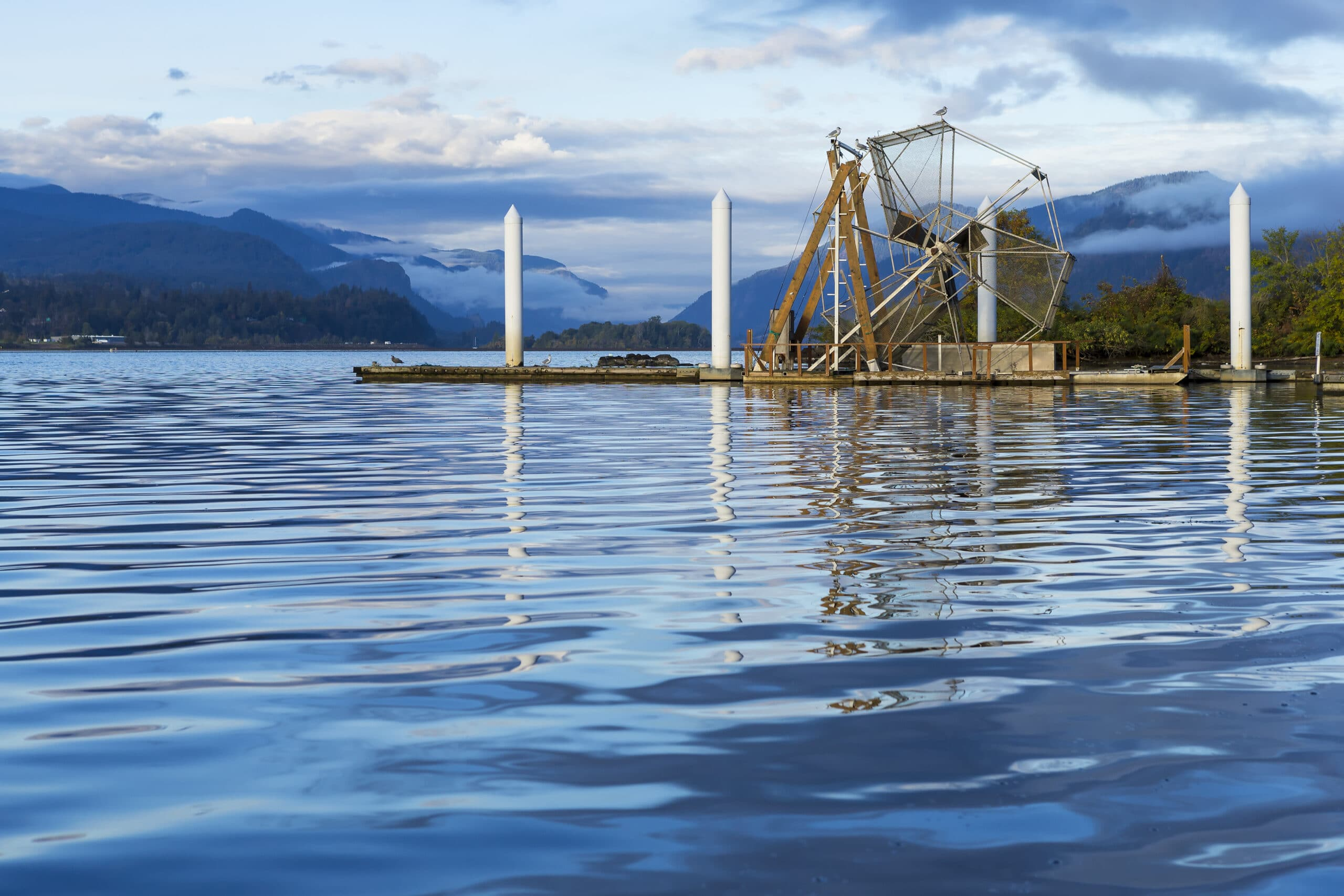 Fish Wheel on the Columbia River Gorge, Washington. A fish wheel is a device for catching fish that operates much as a water-powered mill wheel.